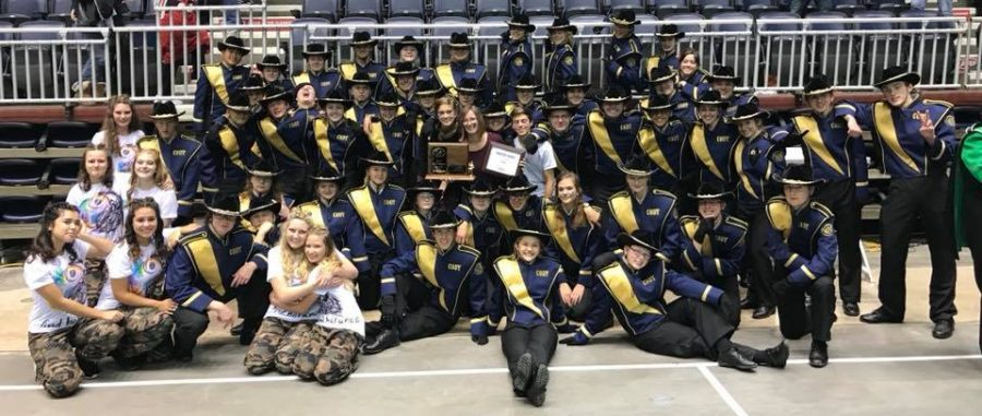 CHS Bronc Band poses with their Superior plaque after earning the award at the State Marching Band Festival.