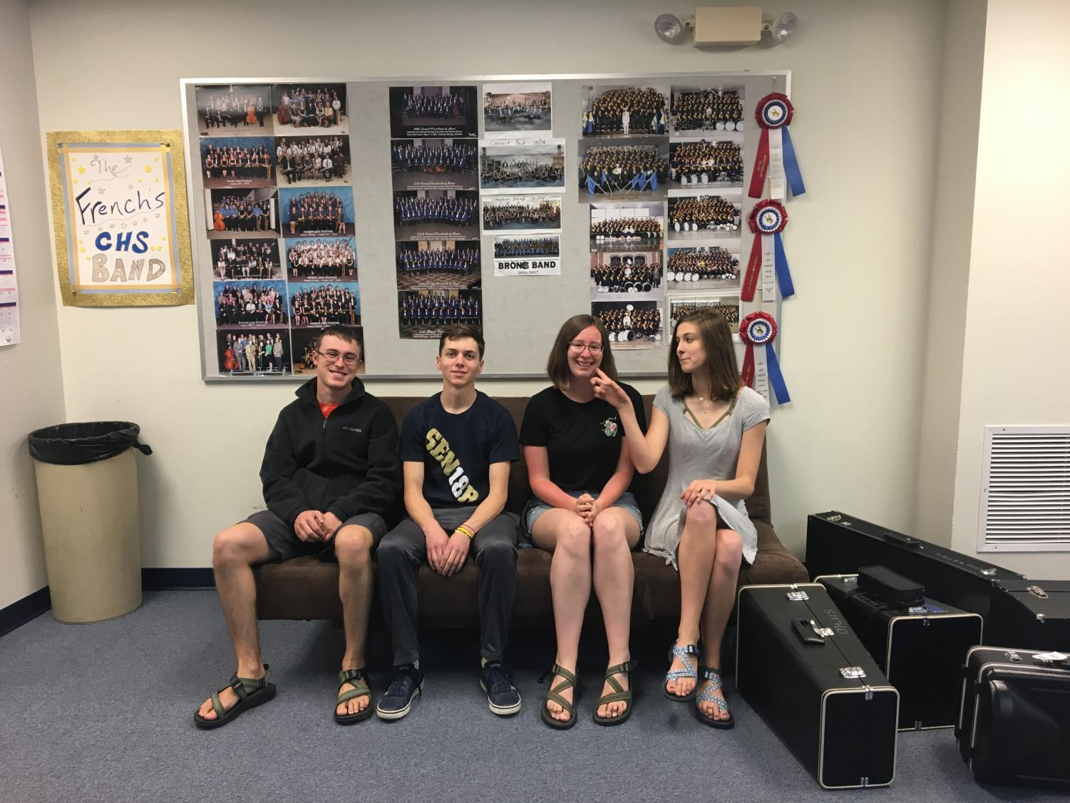 Finnegan Jackson, Duke Dickson, Emma Heydenberk, and Ellie Wooden all sitting in the band room.