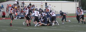 A Cody High School Football player is Tackled by Riverton players