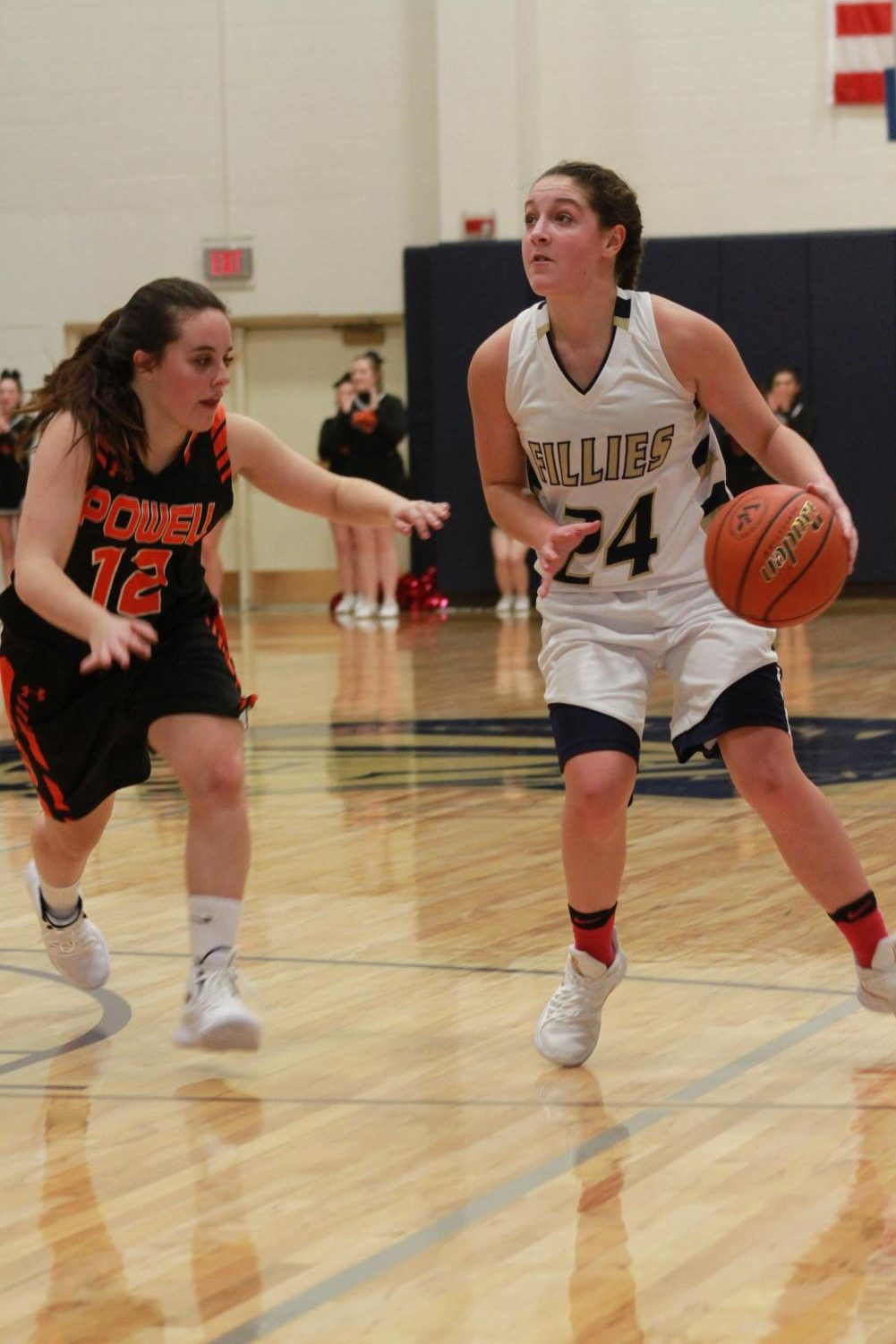 Sophomore Torrie Schutzman dribbles down the court lookiing for an assist.