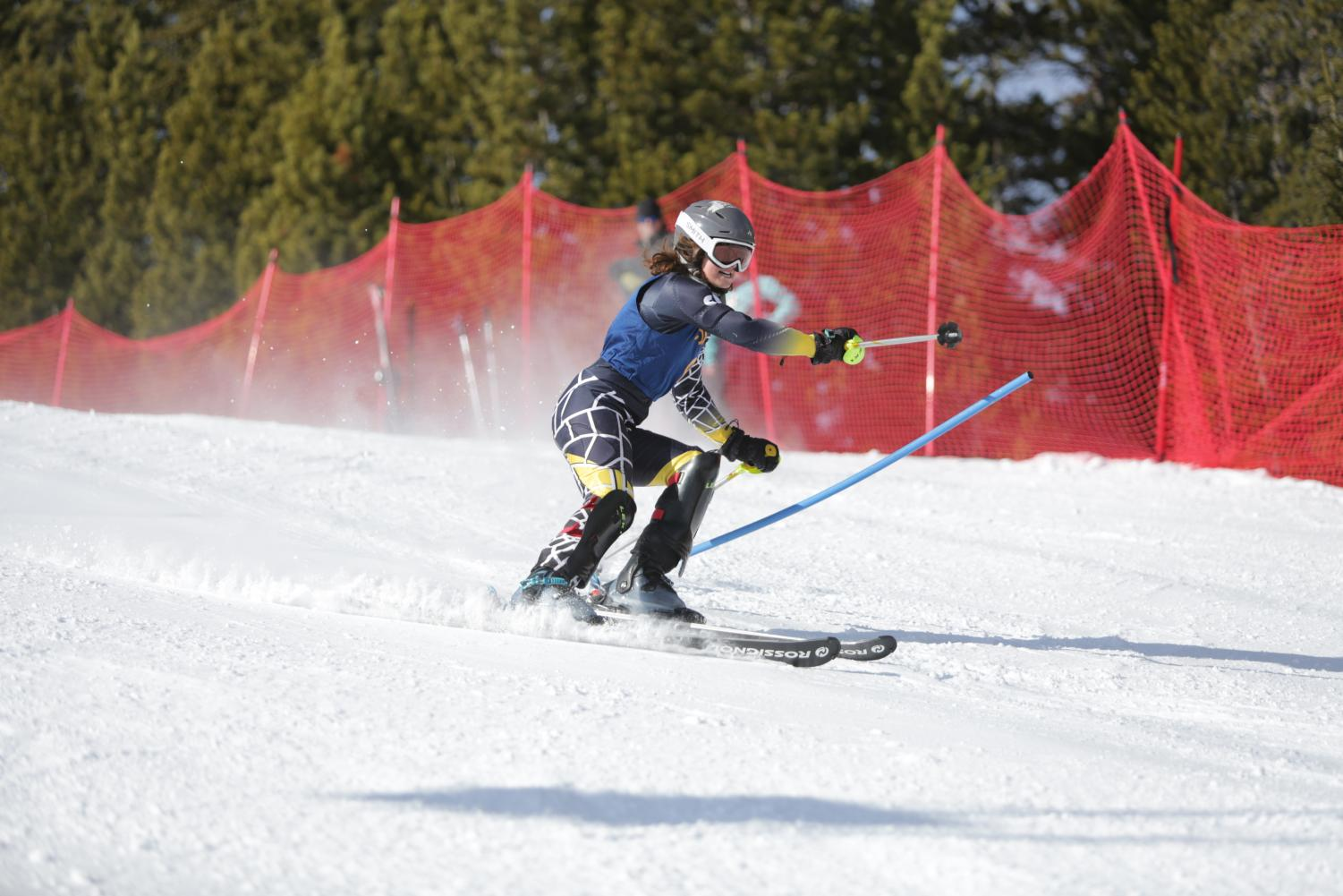 Natalie call races down a run at Red Lodge Mountain during an alpine ski meet. Equipment for skiing, while expensive, usually lasts throughout multiple seasons.
