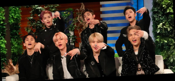 Members Taeyong, (From left; top row to bottom row) Lucas, Ten, Mark, Baekhyun, Taemin, and Kai give the 'SuperM' hand symbol when introducing themselves on Ellen. Super M Sits through an Interview on Ellen Oct 9 before performing