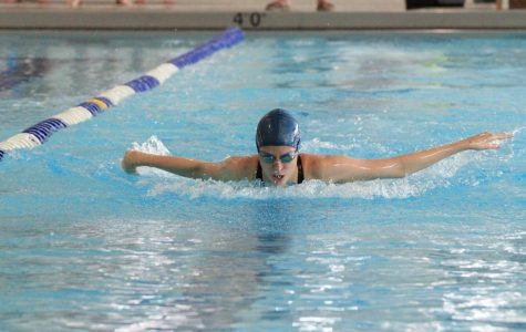 Sophomore Paige Bower swimming at a home meet.