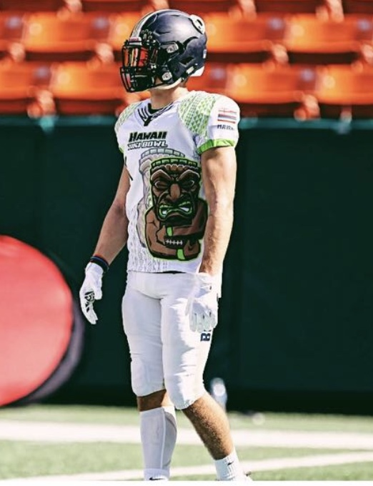 Charlie Beaudrie stands on the football field during a game in Oahu while playing in the Tiki Bowl.
